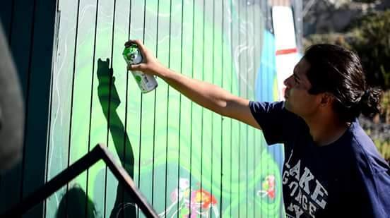 Rikis painting graffiti in Chile